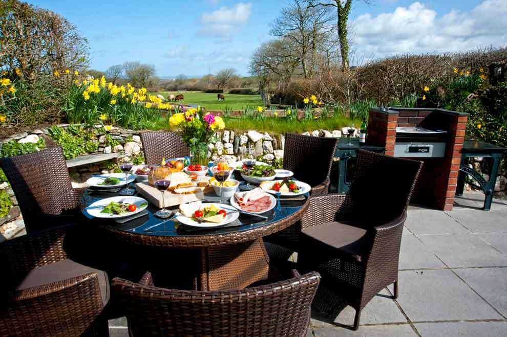 Enjoy a BBQ overlooking the meadow and beyond at Meadowview Cottage a luxury cottage Cornwall