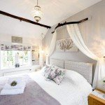 Spacious Super King Bedroom overlooks the garden in our luxury cottage Cornwall