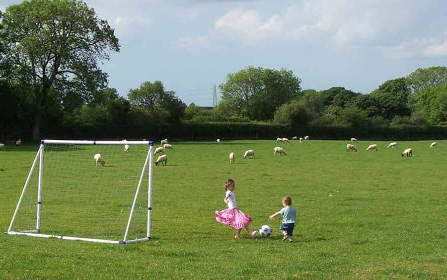 Your children can enjoy the freedom of playing in the meadow at our family friendly and romantic luxury self catering cottages in Cornwall