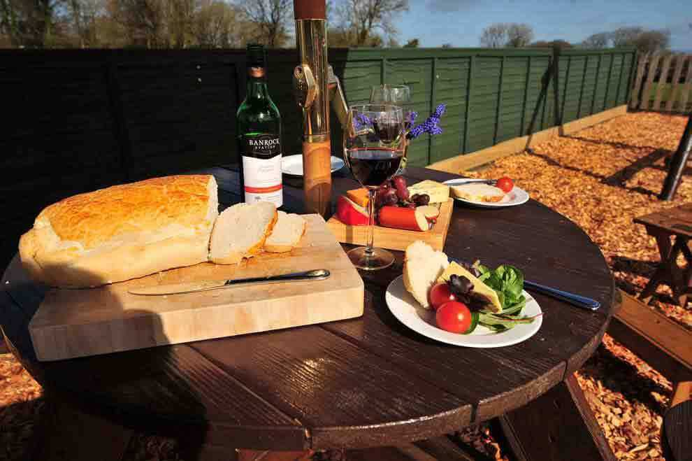 Parents can enjoy lunch with their children playing in the enclosed Play Park at Meadowview Cottage a luxury cottage Cornwall