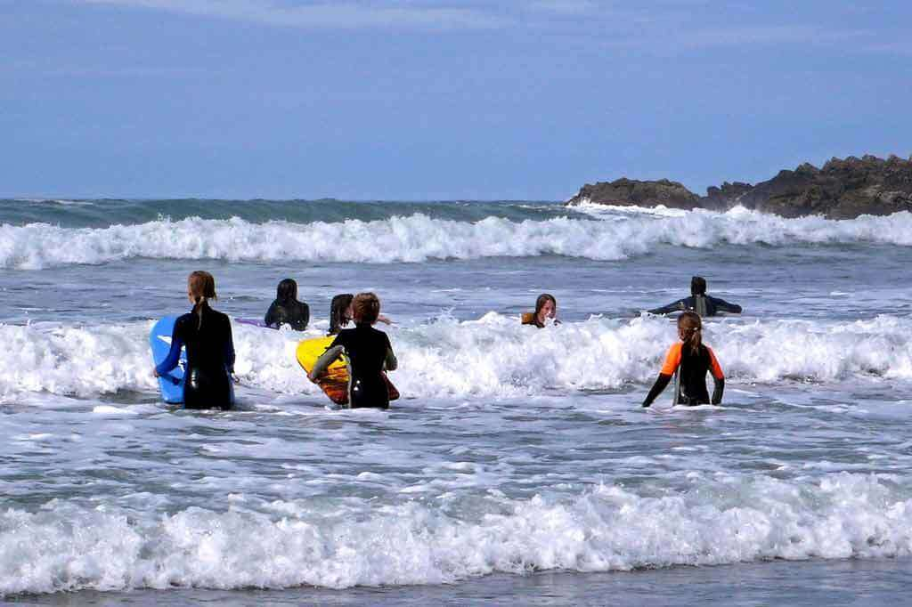Family fun learning to surf in North Cornwall at Crackington Haven 10 mins from our Luxury Self-Catering Cornwall