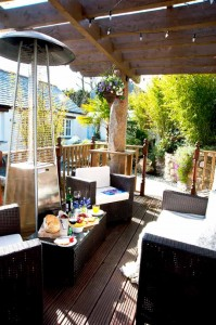Decking area in tropical style garden luxury cottage Cornwall Cornwall Self Catering Luxury